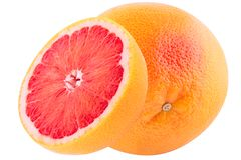 En och halv grapefruktfrukt som isoleras på vit bakgrund med Arkivfoton