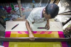 En ombyggnad för Jamdani sareearbetare en gungarulle Royaltyfria Foton