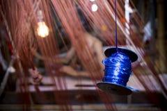 En ombyggnad för Jamdani sareearbetare en gungarulle Royaltyfria Bilder