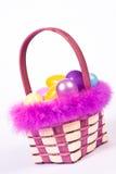 Påskkorg med färgrika ägg Fotografering för Bildbyråer