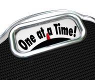 En på en gång gräla på för fetma för ordskala överviktigt fett Arkivfoton