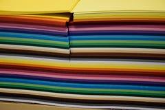 En packe av kulört papper för konst och quilling Fotografering för Bildbyråer