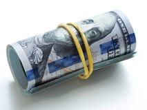En packe av pengar som binds med en gummiband Royaltyfri Fotografi