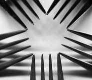En pentagonform som skapas av fem gafflar royaltyfri foto
