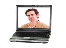 En persondator med en man arkivbild