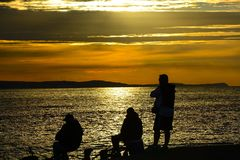 En pescados en la puesta del sol Imagen de archivo libre de regalías