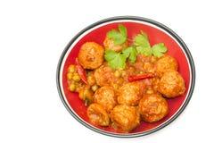 En platta av kokta köttbullar med stekte tomater Royaltyfria Foton