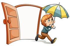 En pojke med ett paraply Arkivfoton