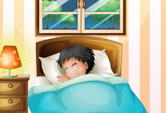 En pojke som soundly sover i hans rum Arkivfoton