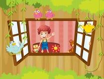 En pojke som vinkar på fönstret med fåglar Royaltyfria Bilder