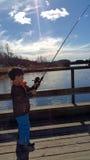 En pojke tycker om att fiska Royaltyfria Foton