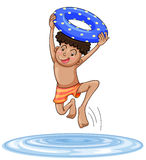 En pojkedykning in i vatten Arkivfoto