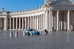 A police car presides over the deserted Piazza San Pietro.