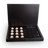 En öppen ask av choklader Royaltyfria Bilder
