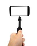 En prenant le selfie - remettez le monopod de prise avec le téléphone portable Images libres de droits