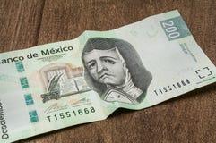 En räkning för 200 mexikanska pesos verkar för att vara ledsen Royaltyfri Fotografi