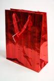 En röd gåvapåse Arkivbild