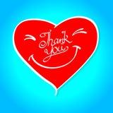 En röd leendehjärta med ord tackar dig Arkivfoton