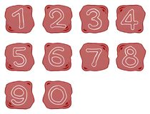 En rödaktig Brown sten av alfabetnummer 0-9 Arkivbilder