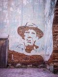 En revolutionärframsida på en vägg Arkivbild
