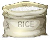En säck av vita ris Arkivfoto