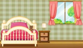 En säng och en lampa Arkivfoto