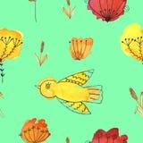 En sömlös modell med fåglar och blommor på en grön bakgrund arkivbilder