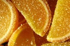 En söt efterrätt Marmeladskivor och gelébönor Stycken av söta lobules Royaltyfria Bilder