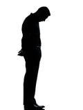 En SAD ensam silhouette för affärsman royaltyfri bild