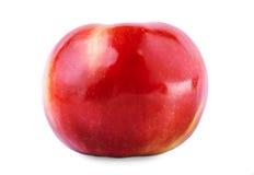 En saftig röd äpplenärbild Mogen, näringsrik, smaklig ljus frukt, på en vit bakgrund En healthful frukost royaltyfria bilder