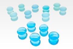 En samling av blåa Glass juvlar Royaltyfria Bilder