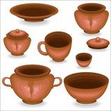 En samling av lerakitchenware En kruka, en kopp, en bunke, en maträtt är nödvändig i köket De lagar mat mat i den, äter den krukm royaltyfri illustrationer