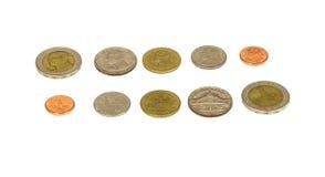 En samling av mynt för thailändsk baht Arkivfoton