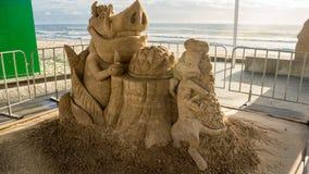 En sandskulptur av den Lion King filmen Arkivfoto