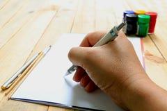 En schets die trekken schilderen Stock Foto's