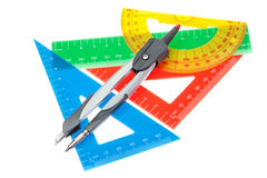 En set av linjaler för skolan och en kompass. Royaltyfria Foton