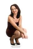 en sexig plattform kvinna för scale arkivfoton