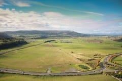 En sikt av de gröna fälten av Stirlingshire royaltyfria foton
