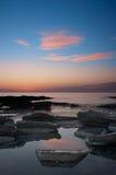 En sikt av solnedgången i Cypern Arkivfoton