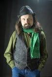 En skäggig man täckte en hatt Fotografering för Bildbyråer