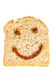 En skiva av bröd med nutellaleende Royaltyfri Fotografi