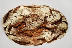 En släntra av rågbröd på vit Fotografering för Bildbyråer