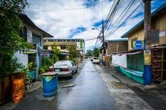 En smal gränd i Poblacion, Makati, tunnelbana Manila, Philippinen Fotografering för Bildbyråer