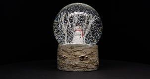 En snögubbe i en snowglobe royaltyfri foto