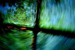 En snurrrörelse av en pölreflexion av träd` s royaltyfria foton