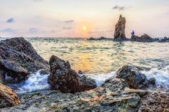 En solnedgång på den Jurassic kusten Arkivbilder
