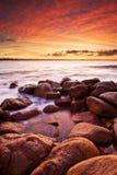 En soluppgång på port Elliot Beach arkivbilder