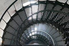 En spiraltrappuppgång inom en fyr Arkivfoto