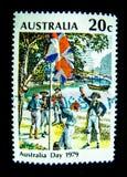 En stämpel som skrivs ut i Australien, visar en bild av den Australien dagen 1979 på ett värde på cent 20 Arkivbilder