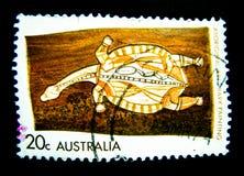 En stämpel som skrivs ut i Australien, visar en bild av för konstskället för sköldpaddan infödda målningar på värde på cent 20 Royaltyfria Foton